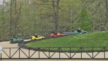 Wide shot of four go karts traveling the Speed O Drome race track