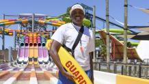Hurricane Harbor lifeguard standing in front of Wahoo Racer
