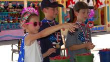 Kids playing ring toss at the Summer of Games