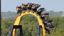 BATMAN: The Ride cresting at the top of the vertical loop