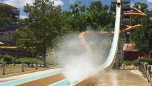 Big splash as guests rides Paradise Plunge water slide