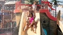 Family playing in kids water area