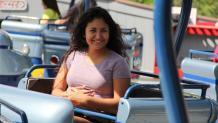 Smiling girl riding Fiddlers Fling