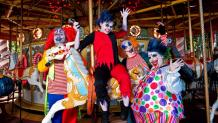Fright Fest zombies dressed as clowns on the carousel