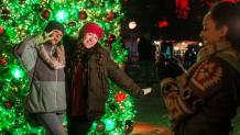 Friends taking festive Holiday in the Park photo