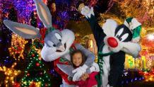 Holiday <em>Bugs</em> and <em>Sylvester</em> posing with guest