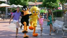 Family skipping with Looney Tunes characters