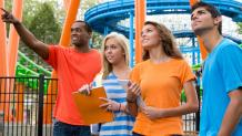 guests in park by roller coaster