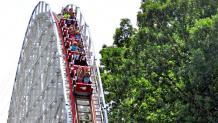Wide shot of the Screamin Eagle train descending the first drop