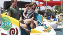 Guests enjoying rotating and spinning car of Spinsanity
