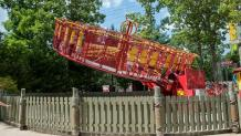 Guests on Swashbuckler, a red round ride that spins guests in circles