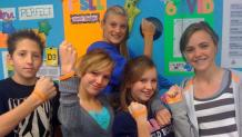 Pre-teens showing wristbands