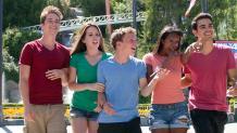 teens walking and smiling