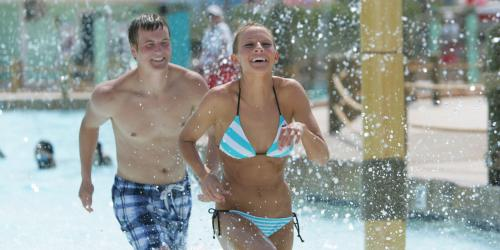 teens running through wave pool