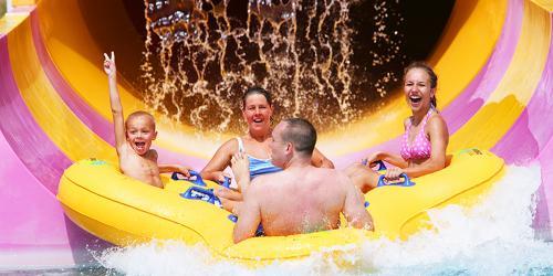 Family on water slide