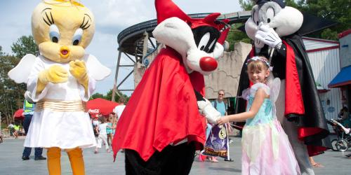 Looney Tunes gang dressed up and meeting guests.