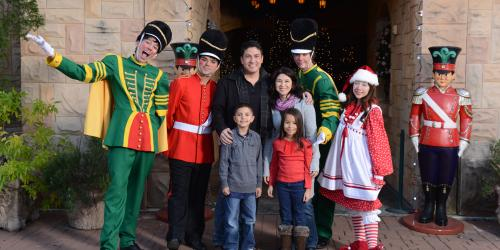 Family with characters at Holiday in the Park