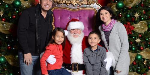 Family posing with Santa