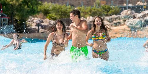 Teens splashing in water