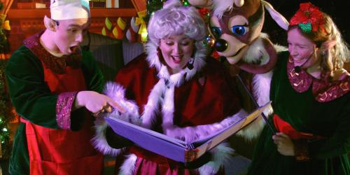 Mrs. Claus reads a story to children during Holiday in the Park at Six Flags New England