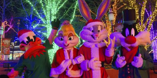 Looney Tunes in holiday costumes during Holiday in the Park at Six Flags New England