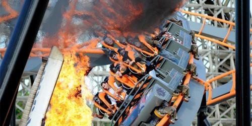 Riders face flames of Apocalypse Coaster