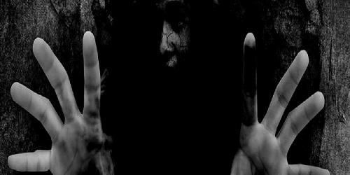 Scary figure reaching through the screen
