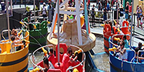 Guests enjoying Daffy Duck Bucket Blasters