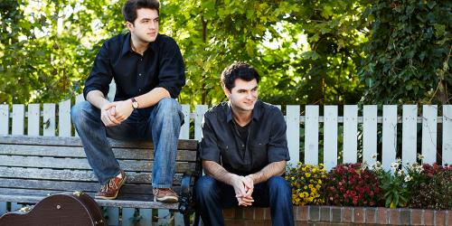 The Como Brothers on a bench