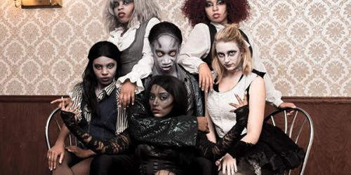 Five female zombie dancers surrounding the male Dr. Fright character
