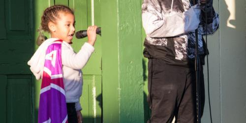 Two children sing karaoke