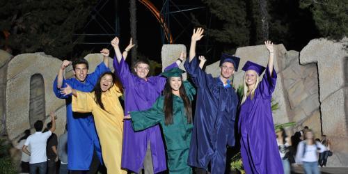 high school graduates celebrating in front of Goliath
