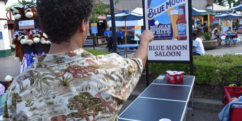 Guest playing Pong Toss during Food and Brew Festival at Six Flags New England