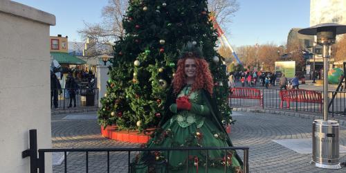 evergreen queen in front of holiday memories tree