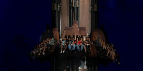 Guests riding Giant Drop at night