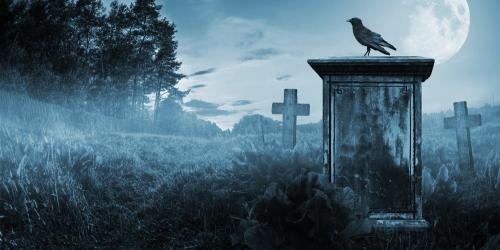 Raven standing on top of a tall gray tombstone in a spooky nighttime graveyard