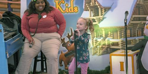 A young girl performs karaoke