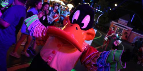 Daffy at night during Mardi Gras Festival in his festive attire