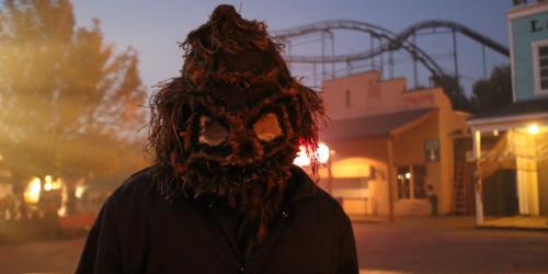 Creepy scarecrow in jumpsuit standing in front of Demon