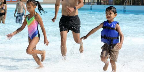 kids running in wading pool
