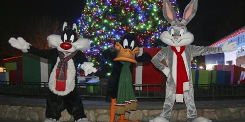 Holiday themed Looney Tunes in front of Christmas tree
