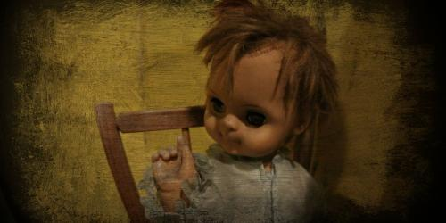 close up of creepy baby doll in Manslaughter Manor