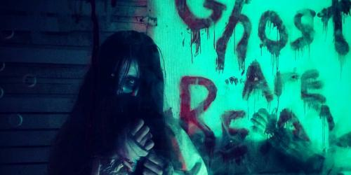 Ghoul with a bloody message that reads ghosts are real at Fright Fest