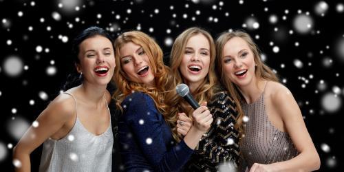 carolers singing holiday songs