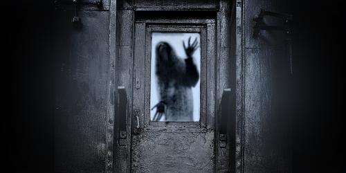 Door with silhouette in window