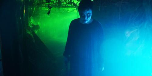Spooky woman in Wicked Woods during Fright Fest at Six Flags New England