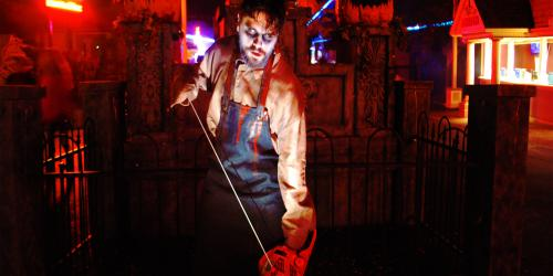 Bloody man with chainsaw in Main Street Graveyard during Fright Fest at Six Flags New England