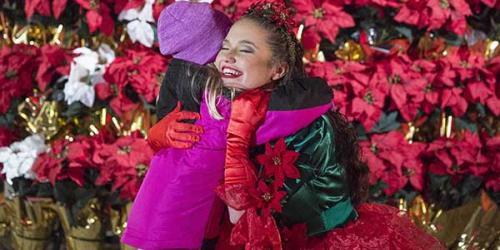 young girl hugging poinsettia princess