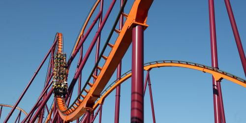 Raging Bull coaster with a full train coming down a curve