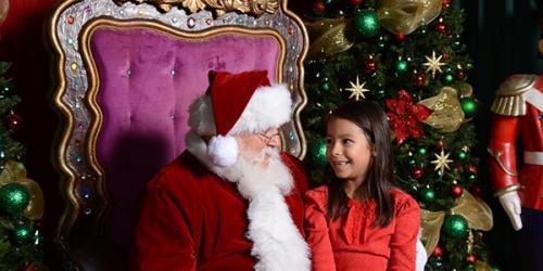 Girl sitting with Santa